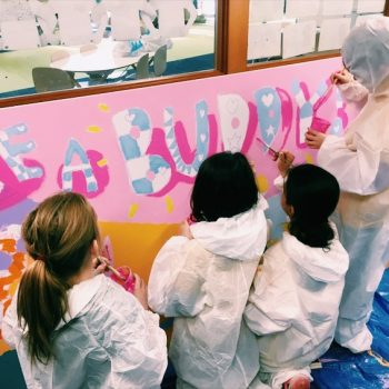 children making pink sign