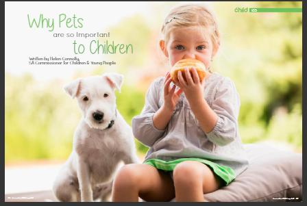 girl eating orange with dog