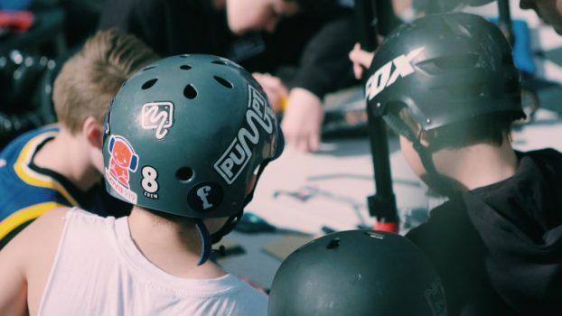 children in skating helmets