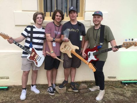 4 boys with guitars
