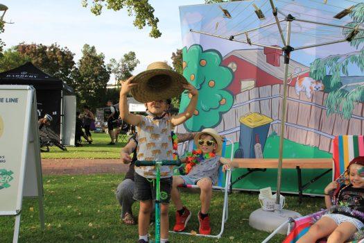 children in front of cartoon wall