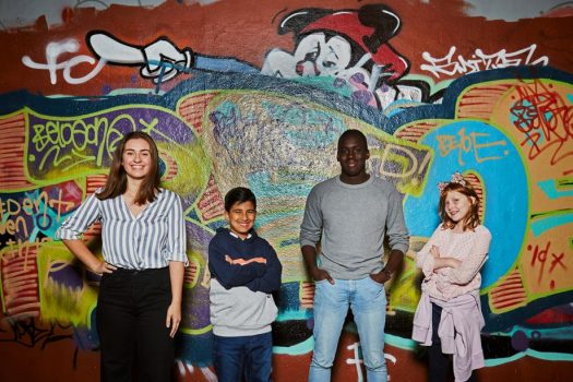 children in front of painted wall