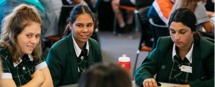 schoolgirl wearing green jacket