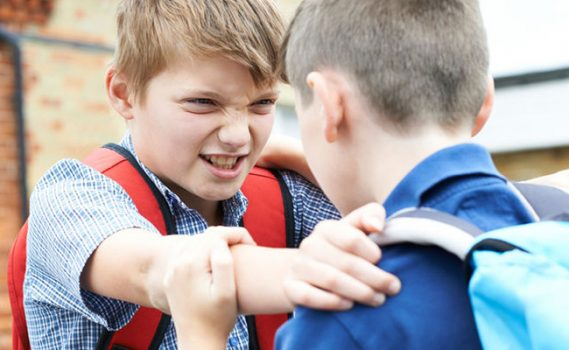 a boy being bullied by another boy