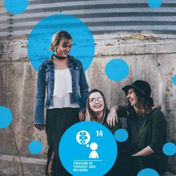 3 teenage girls sitting against wall