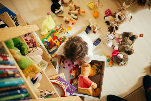 Birdseye view of child with toys