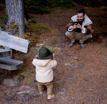 man taking photo of child