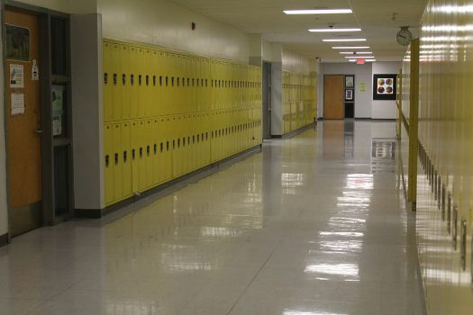 school hallway with yellow lockers