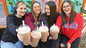 group of girls with smoothies
